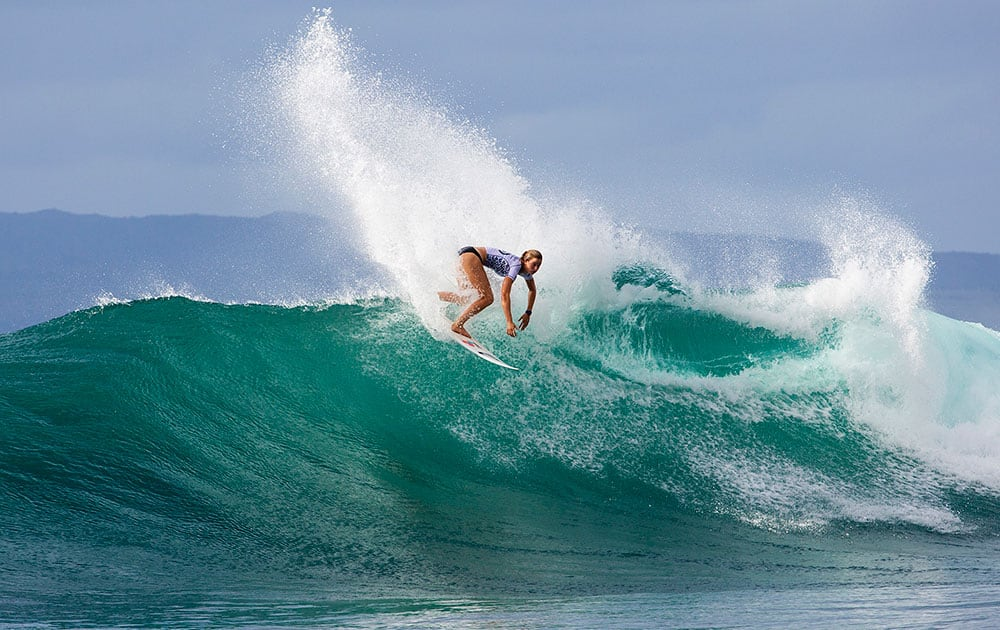 In this photo provided by the Association of Surfing Professionals Bianca Buitendag of South Africa, wins her Round 1 heat at the Target Maui Pro, in Maui, Hawaii.