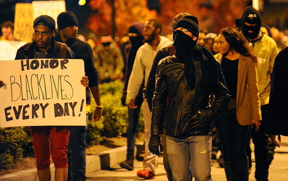 Protesters march through the downtown area before blockading all lanes of Interstate 75/85 northbound near the state capitol building one day after the Ferguson, Missouri, grand jury decision not to indict police officer Darren Wilson in the shooting of Mike Brown,  in Atlanta.