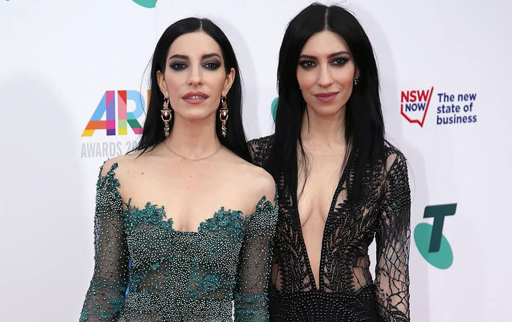 Australia's The Veronicas with sisters Lisa, left, and Jessica Origliasso arrive for the Australian Recording Industry Association (ARIA) awards in Sydney.