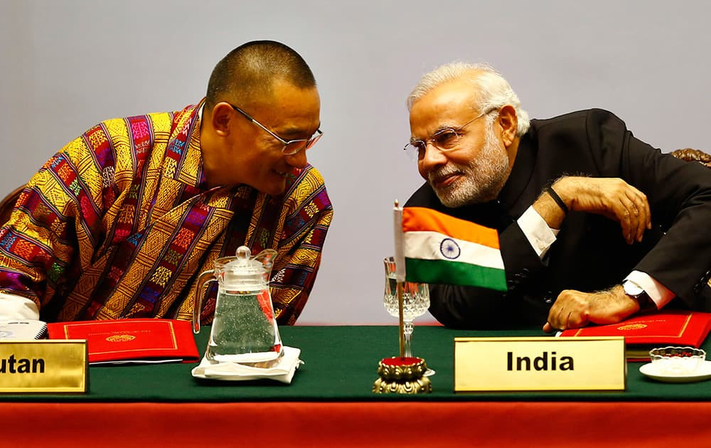 Bhutanese Prime Minister Tshering Tobgay, speaks with Indian Prime Minister Narendra Modi during the 18th summit of the South Asian Association for Regional Cooperation (SAARC) in Katmandu, Nepal.
