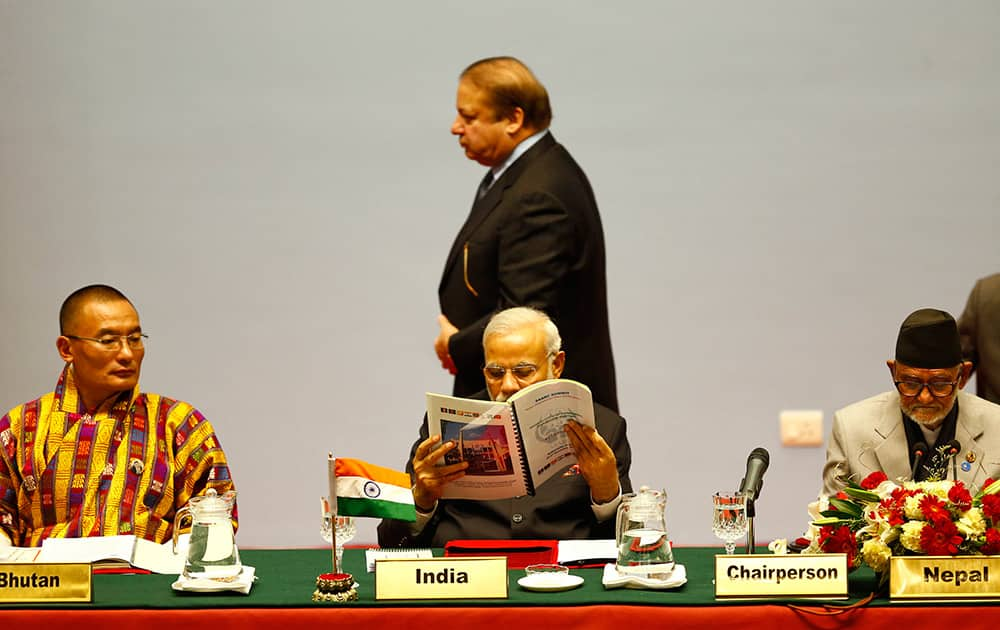Pakistani Prime Minister Nawaz Sharif walks past Indian Prime Minister Narendra Modi during the 18th summit of the South Asian Association for Regional Cooperation (SAARC) in Katmandu, Nepal.