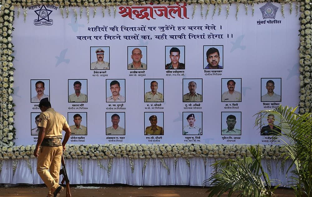 A policeman walks past a memorial in remembrance of those who died during the Mumbai attack, on the sixth anniversary of the attack in Mumbai.