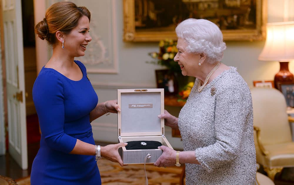 Britian's Queen Elizabeth II is presented with the Federation Equestre Internationale (FEI) lifetime achievement award for her devotion to equestrian sport by Princess Haya of Jordan, left, at Buckingham Palace, London.