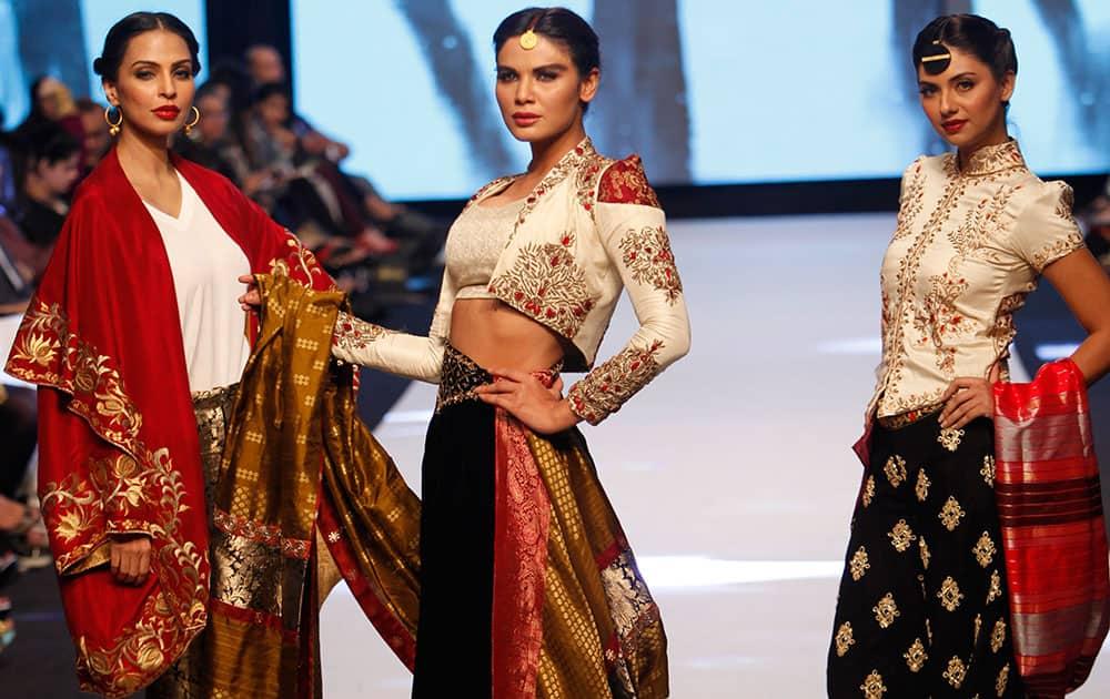 Pakistani models present creations by designer Sanam Chaudhri, during Pakistan Fashion Week.