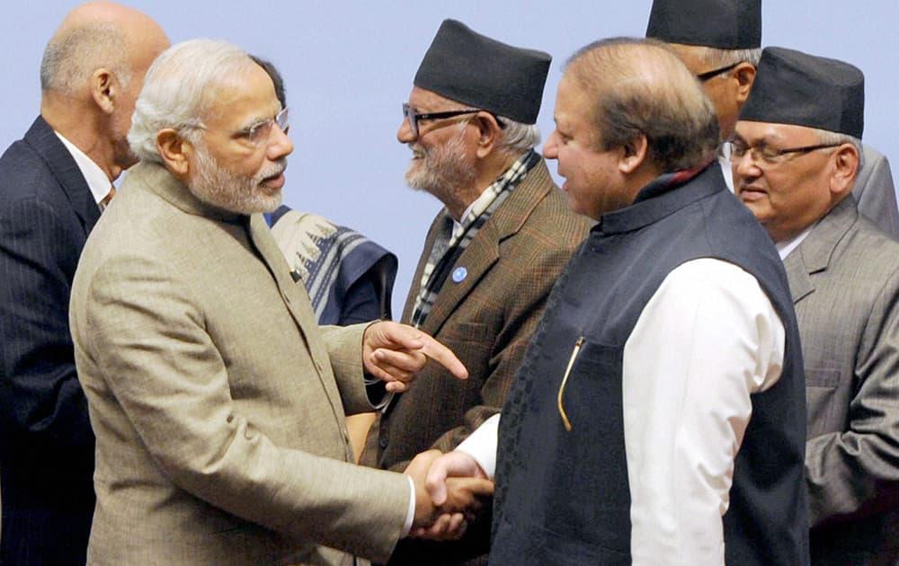 Prime Minister Narendra Modi shakes hands with his Pakistani counterpart Nawaz Sharif at the 18th SAARC Summit in Kathmandu, Nepal.