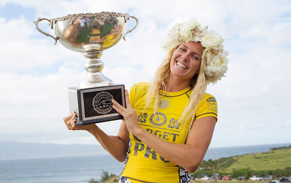 This photo provided by the Association of Surfing Professionals, Stephanie Gilmore, of Australia, poses with her ASP World Title trophy after winning the Target Maui Pro at Honolua Bay, Maui, Hawaii.