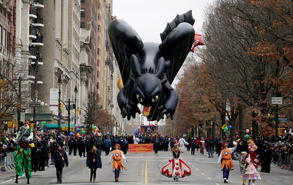 A balloon in the shape of a character in the children's cartoon movie 'How To Train Your Dragon' cruises along Central Park West during the Macy's Thanksgiving Day Parade, in New York.