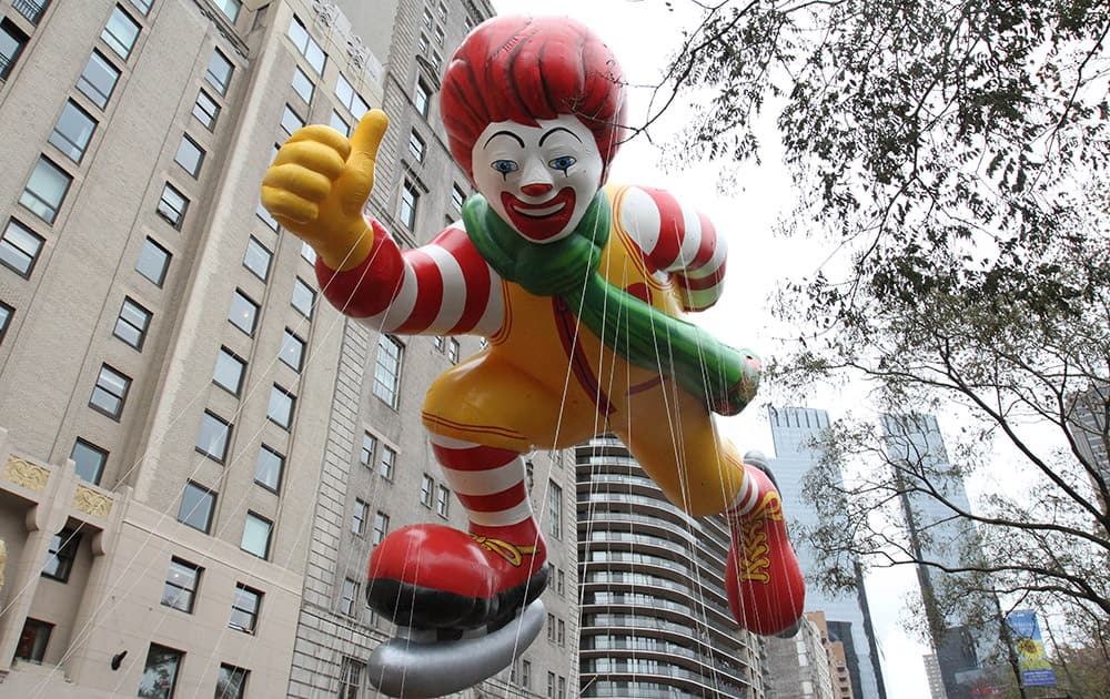 The Ronald McDonald balloon makes it way across New York's Central Park South during the Macy's Thanksgiving Day Parade, in New York.