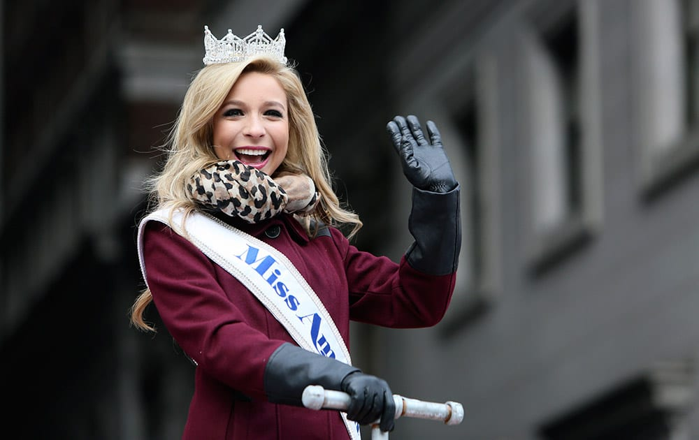 Miss America Kira Kazantsev waves to spectators during the 95th annual Thanksgiving day parade, in Philadelphia.