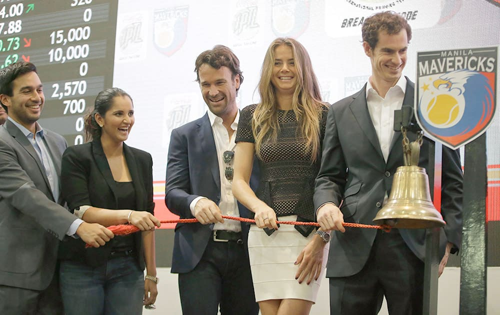 Tennis players, Andy Murray of Britain, Daniela Hantuchova of Slovakia, Carlos Moya of Spain, Sania Mirza of India and Treat Huey of the Philippines, ring the bell at the opening of the trading at the Philippine Stocks Exchange to coincide with the inaugural listing of the IPTL (International Premier Tennis League) at the financial district of Makati city, east of Manila, Philippines.