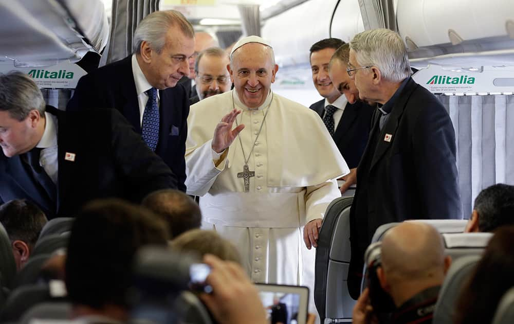 Pope Francis talks to journalists during a press conference aboard the flight towards Ankara. Pope Francis travels to Turkey this weekend amid new Muslim-Christian tensions and a violent war next door, with Islamic State militants seizing chunks of territory in Iraq and Syria and sending 1.6 million refugees across the border into Turkey.