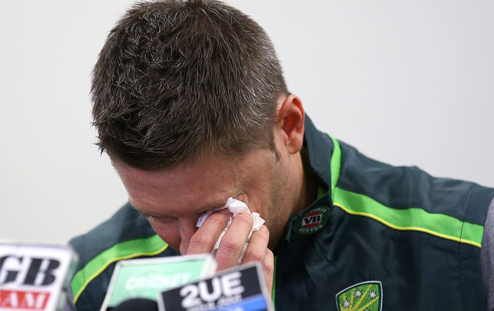 Australian cricket captain Michael Clarke wipes away a tear while making a statement at the Sydney Cricket Ground following the death of Australian cricket player Phil Hughes in Sydney.