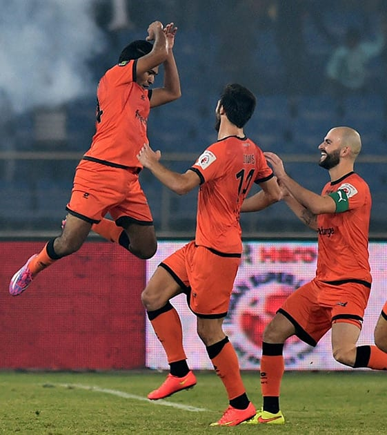 Delhi Dynamos FCs Manish Bhargav (L) celebrate with team mates after scoring their 4 goal against Mumbai City FC during the ISL 2014 match at Nehru Stadium in New Delhi.