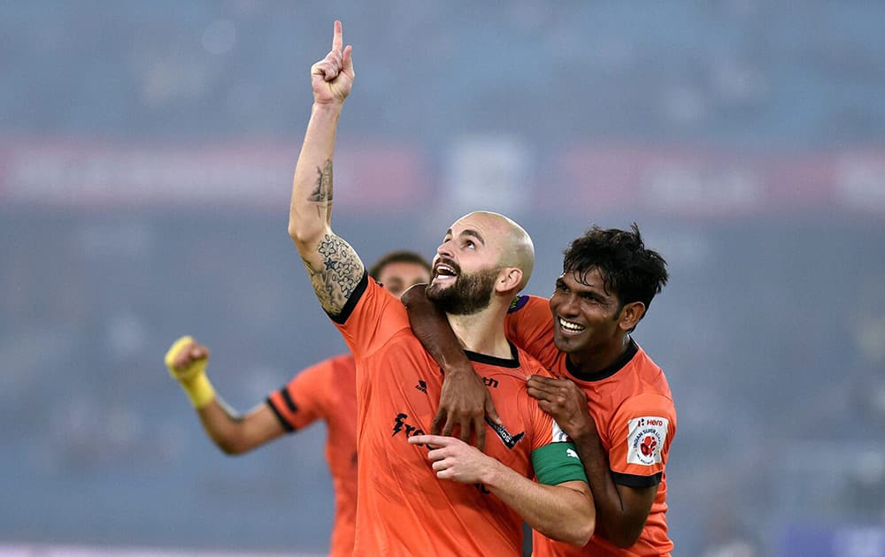 Delhi Dynamos FC captain Hans Mulder celebrates after scoring his sides first goal against Mumbai City FC during their ISL match at Nehru Stadium in New Delhi.