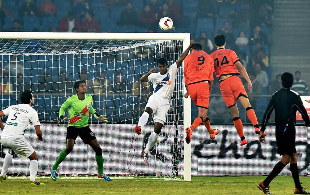 Delhi Dynamos FC (Orange) and Mumbai City FC players in action during their ISL match at Nehru Stadium in New Delhi.