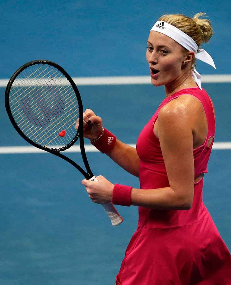 Kristina Mladenovic of the UAE Royals celebrates after getting a point during her women's singles match against Daniela Hantuchova of the Singapore Slammers in the International Premier Tennis League at the Mall of Asia Arena in Pasay city, south of Manila, Philippines.