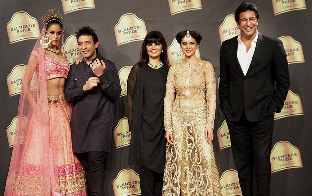 Bollywood actor Aditi Rao Hydari, former Pakistani cricketer Wasim Akram, and designers Neeta Lulla and Suneet Varma at a fashion show in Mumbai.