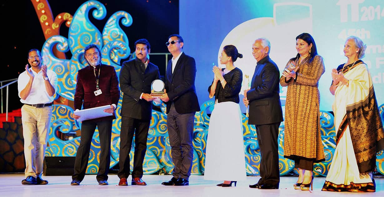 Renowned director Wong Kar-wai is conferred with Lifetime Achievement Award by Minister of State for Information and Broadcasting, Rajyavardhan Rathore during the International Film Festival of India, in Panaji. Actors Waheeda Rehman and Nana Patekar, and directors Rakeysh Omprakash Mehra and Ramesh Sippy are also seen.