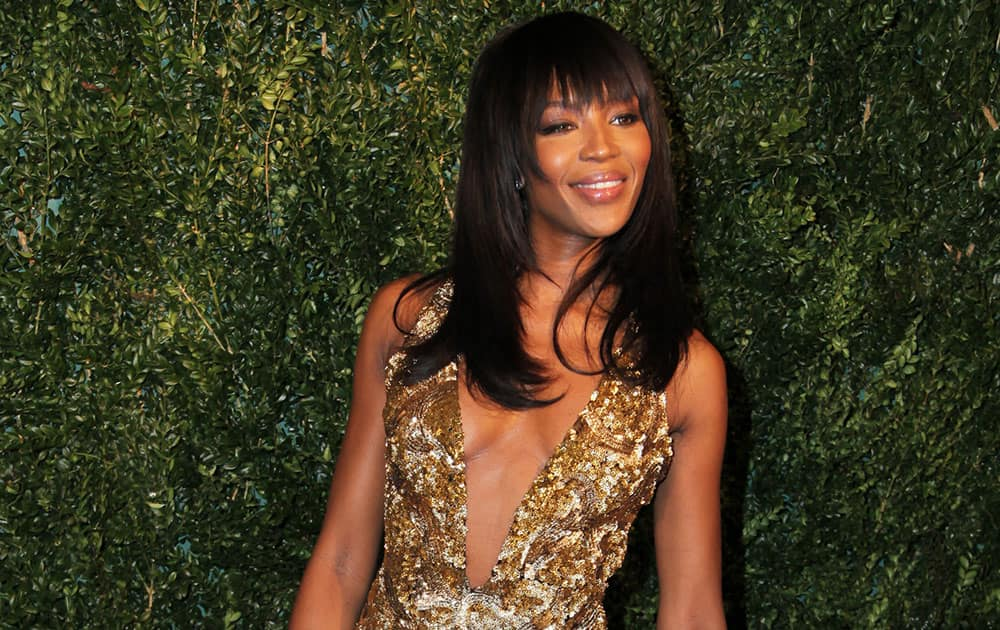 Model Naomi Campbell poses for photographers on arrival at the Evening Standard Theatre Awards.