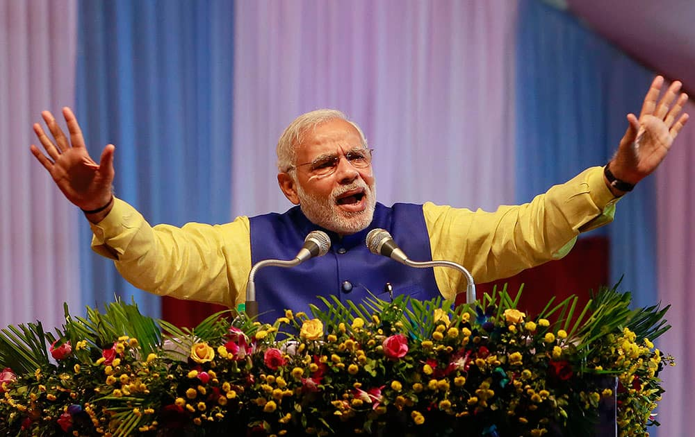 Indian Prime Minister Narendra Modi speaks before flaging off the first passenger train between Mendipathar in Meghalaya state to Gauhati, in Gauhati, capital of the northeastern Indian state of Assam.