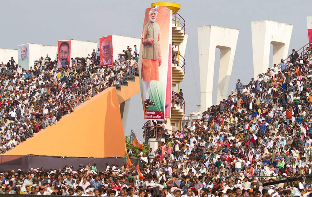 Supporters listen as Indian Prime Minister Narendra Modi addresses Bharatiya Janata Party (BJP) worker's rally in Gauhati.