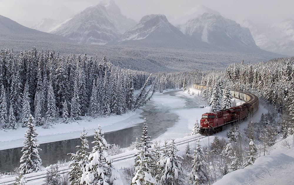 A Canadian Pacific freight train travels around Morant's Curve near Baker Creek, Alberta.