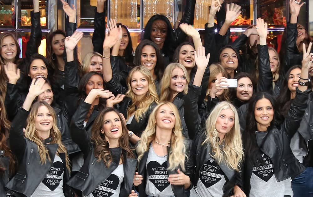 Victoria's Secret models, front row Behati Prinsloo, Alessandra Ambrosio, Candice Swanepoel, Lindsay Ellingson and Adriana Lima pose with other Victoria's Secret models for photographers a day ahead of the Victoria's Secret Fashion show, outside the store in London.