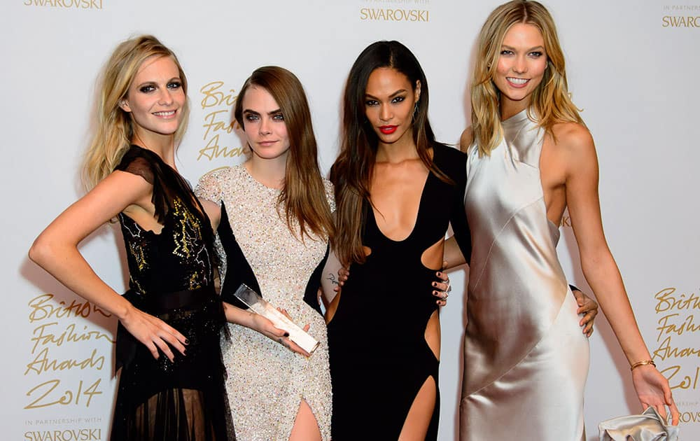 Models Poppy Delevigne, Cara Delevigne, Joan Smalls and Karlie Kloss pose for photographers with her Model of the year award at The British Fashion Awards 2014, in London.