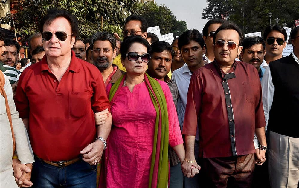 Veteran film actor and BJP leader George Becker, with his wife and actor Joy Goswami along with others participate in rally in Kolkata on Tuesday in support of CBI investigation in Saradha chit fund scam.