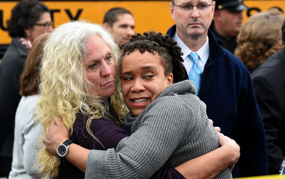 Clovis Stair, left, supervisor of Knox County School psychology, consoles Sunnyview Primary School Principal Sydney Upton near the scene where two school buses serving Chilhowee Intermediate School and Sunnyview Primary School crashed in Knoxville, Tenn.