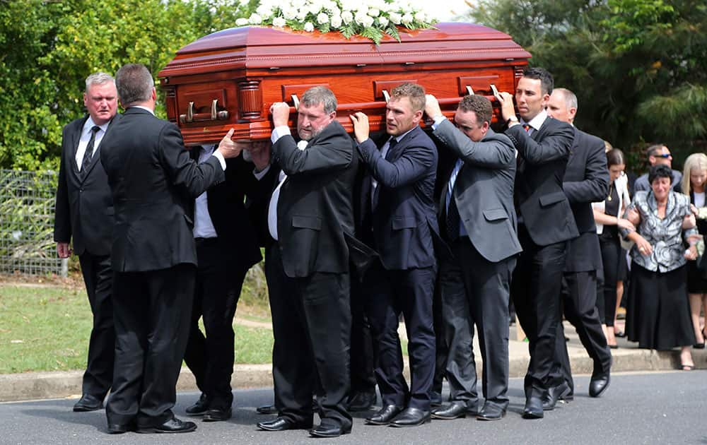 Pall bearers carry the coffin of Australian cricketer Phillip Hughes to the hearse during his funeral in Macksville, Australia.