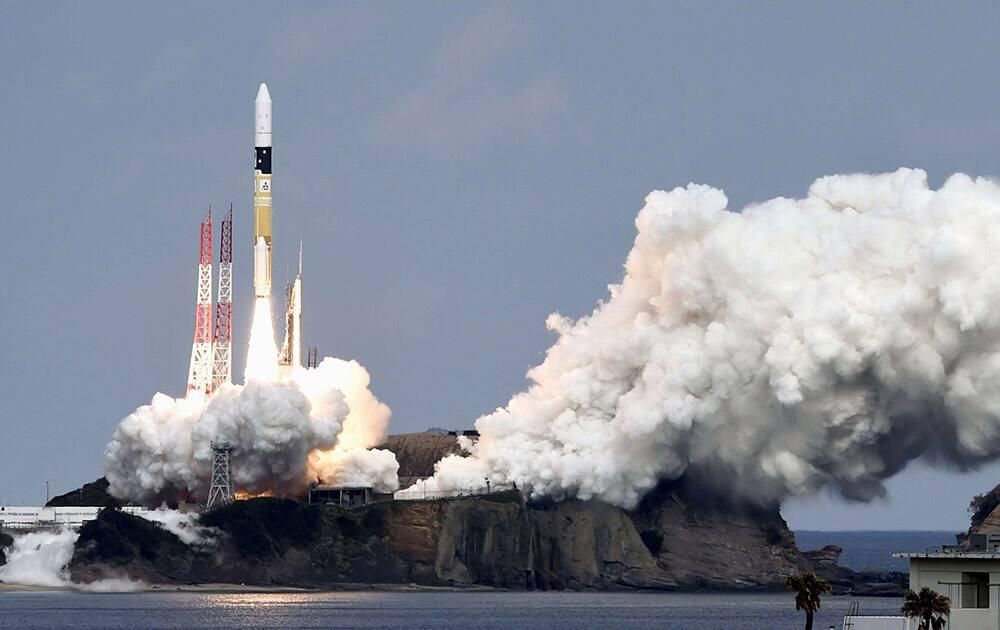 An H2-A rocket carrying space explorer Hayabusa2, lifts off from a launching pad at Tanegashima Space Center in Kagoshima, southern Japan.