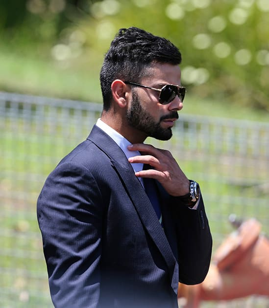Virat Kohli arrives for the funeral of Australian cricketer Phil Hughes in Macksville, Australia.