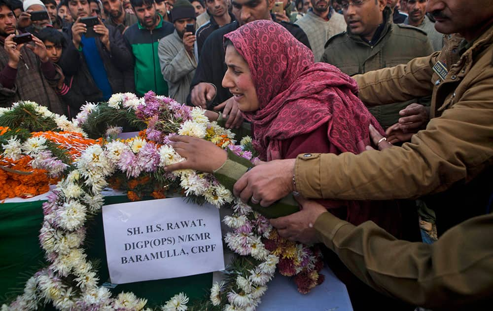 Safeena Shafi, the wife of Indian paramilitary soldier Muhammad Shafi Bhat wails as she lays the wreath on the coffin of her husband during his funeral procession in Buran, Srinagar.