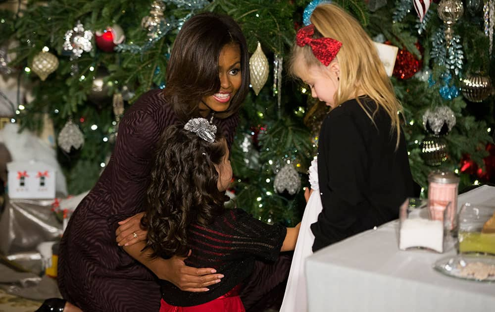 First lady Michelle Obama talks with children of military families during a tour of holiday decorations at the White House in Washington.