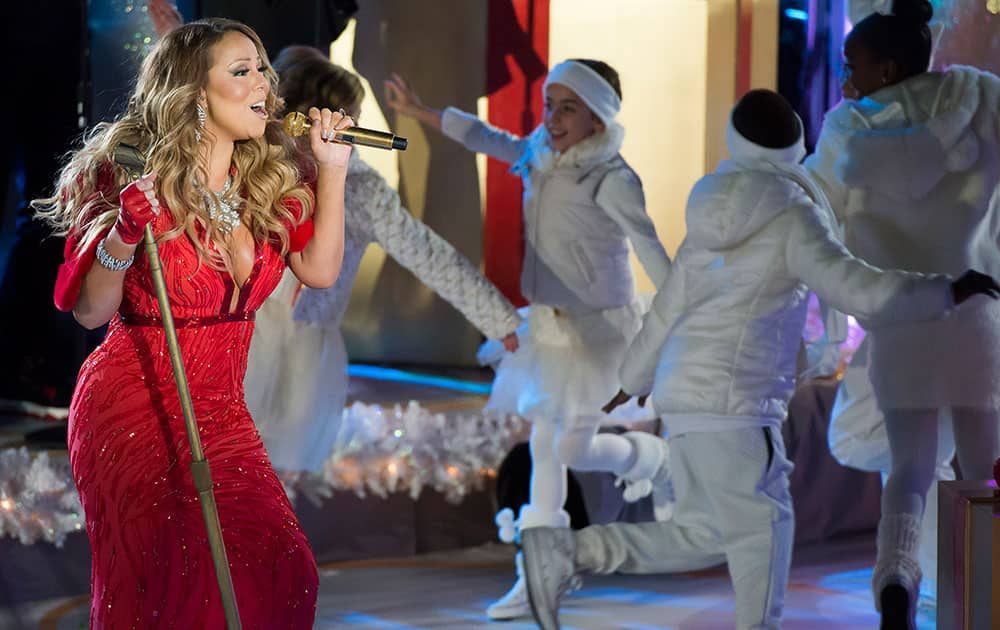 Mariah Carey performs at the 82nd Annual Rockefeller Center Christmas Tree Lighting Ceremony, in New York.