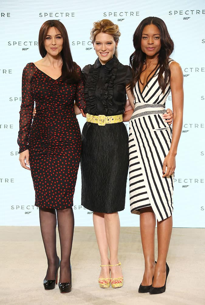 Actresses Monica Bellucci, Lea Seydoux and Naomie Harris pose for photographers at the announcement for the new Bond film, the 24th in the series, at Pinewood Studios in west London.