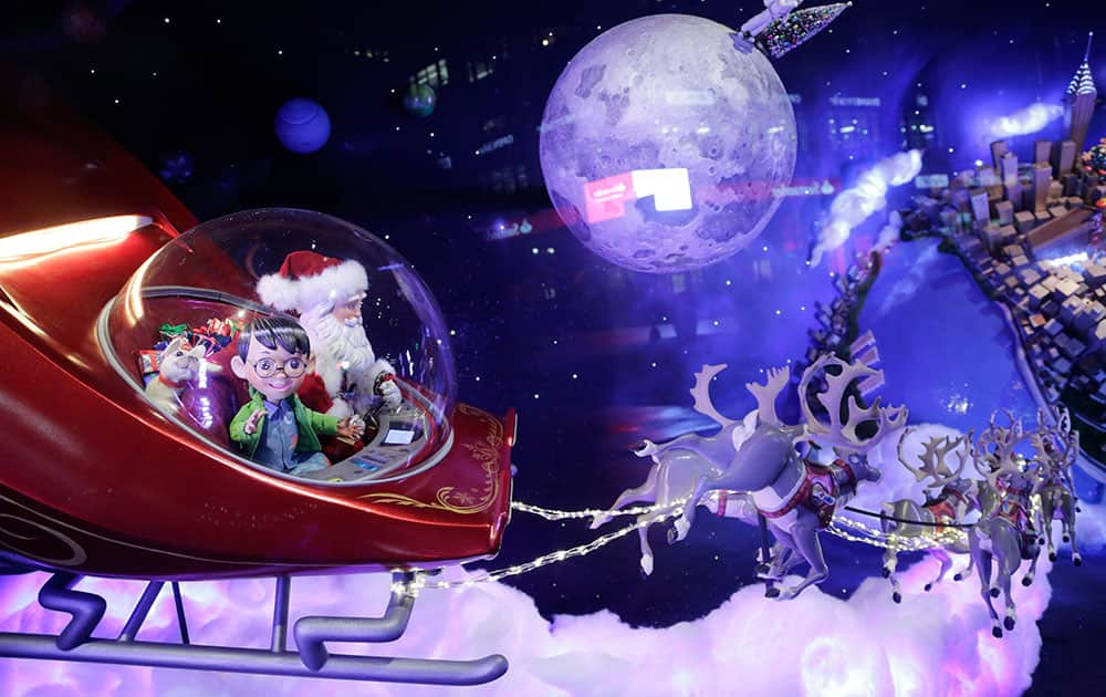 Young explorer Alex and his dog Bella ride in Santa's sleigh as they return to earth in a Macy's department store holiday window in New York. In a series of six displays, an endearing story unfolds of a boy whose magical telescope takes him on a Christmas journey of the planets with none other than Santa Claus.