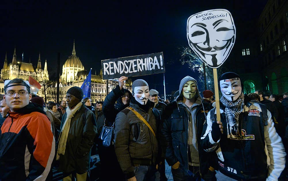 Demonstrators gather on the Kossuth Square in front of the Hungarian Parliament building during an anti-corruption demonstration called 'Our country! Our money! in Budapest, Hungary.