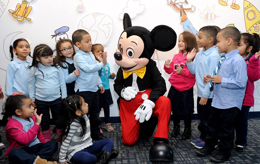 Mickey Mouse and kids celebrate the launch of Disney Imagicademy, a new innovative learning initiative designed for families with children 3 to 8, at The Intrepid Sea, Air & Space Museum in New York.