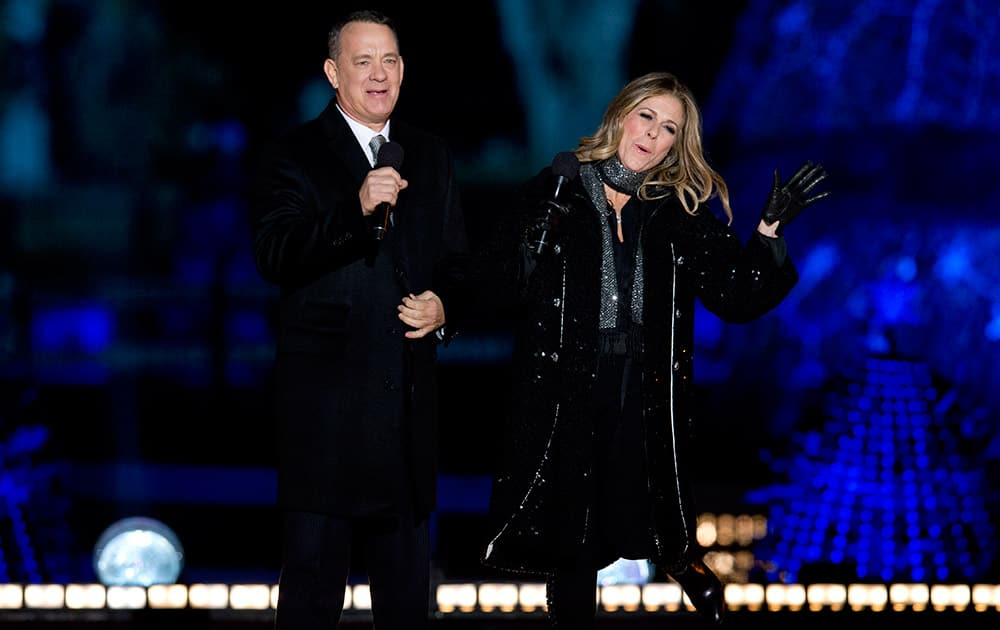 Tom Hanks, and Rita Wilson arrive on stage during the National Christmas Tree lighting ceremony at the Ellipse near the White House in Washington.