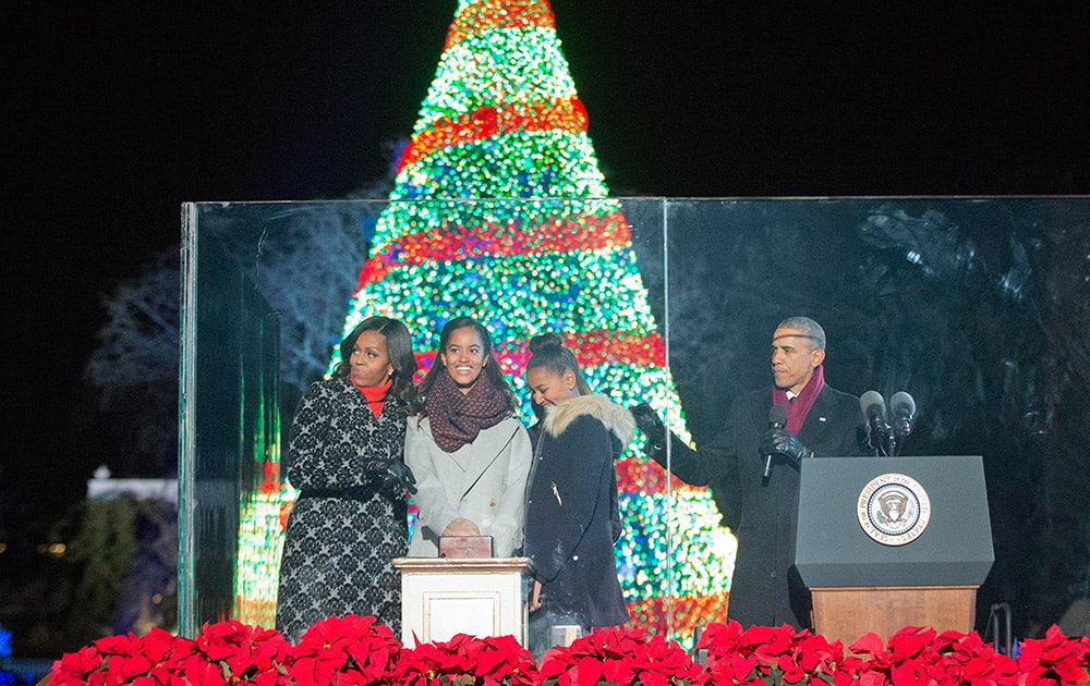 President Barack Obama  with first lady Michelle Obama and daughters Malia and Sasha, participate in the National Christmas Tree lighting ceremony.