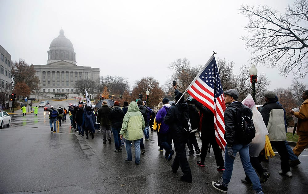 Protesters march to the final stretch to the Missouri Capitol on the last day of a 7-day march, in Jefferson City, Mo.