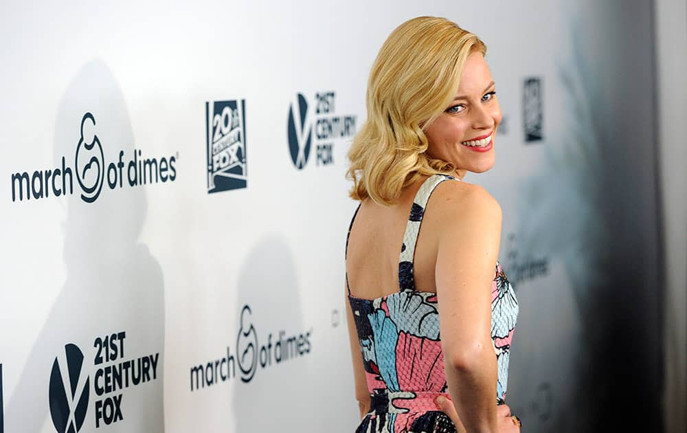 Grace Kelly Award honoree Elizabeth Banks turns back for photographers at the 2014 March of Dimes Celebration of Babies at the Beverly Wilshire Hotel.