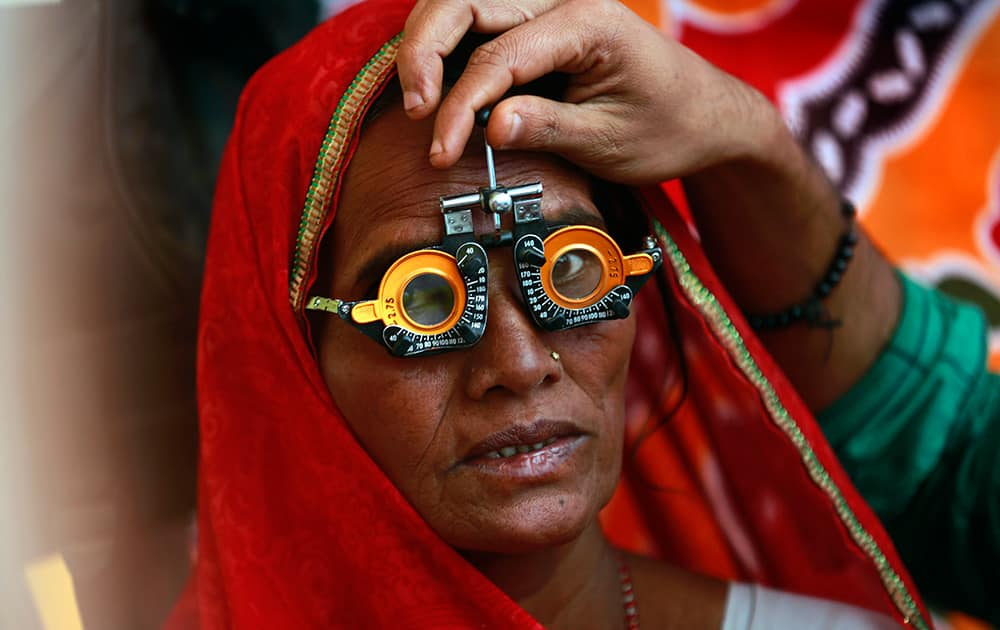 A woman gets her eyes examined at a free medical camp held to mark Bhim Rao Ambedkar's death anniversary in Mumbai.