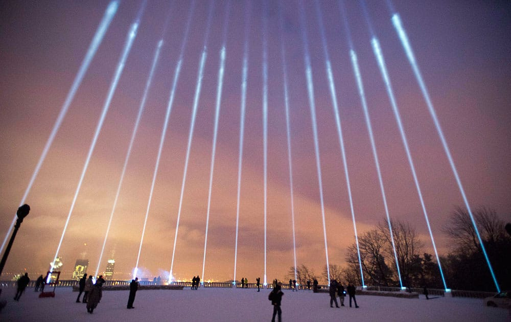 Fourteen lights shine toward the sky during a ceremony on Mount Royal to mark the 25th anniversary of the Polytechnique massacre in Montreal. It was 25 years ago today that a gunman shot and killed fourteen women before taking his own life at the Ecole Poytechnique of the Universite de Montreal.
