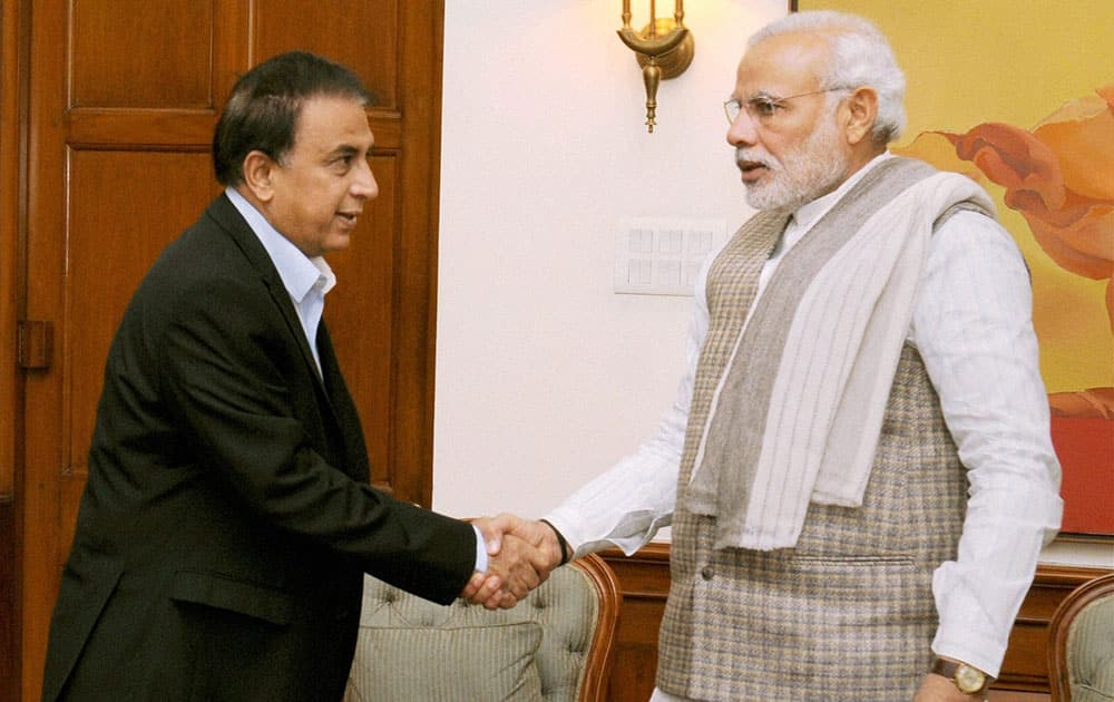 Prime Minister Narendra Modi shakes hand with former cricketer Sunil Gavaskar during their meeting in New Delhi.