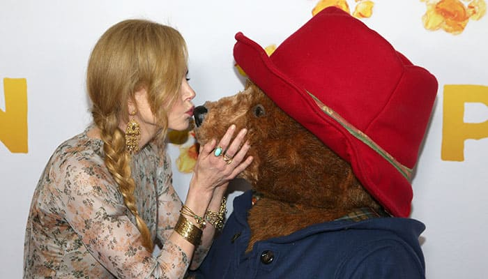 Actress Nicole Kidman, left, kisses the nose of the character Paddington as she arrives for the Australian premiere of her movie 'Padington' in Sydney.