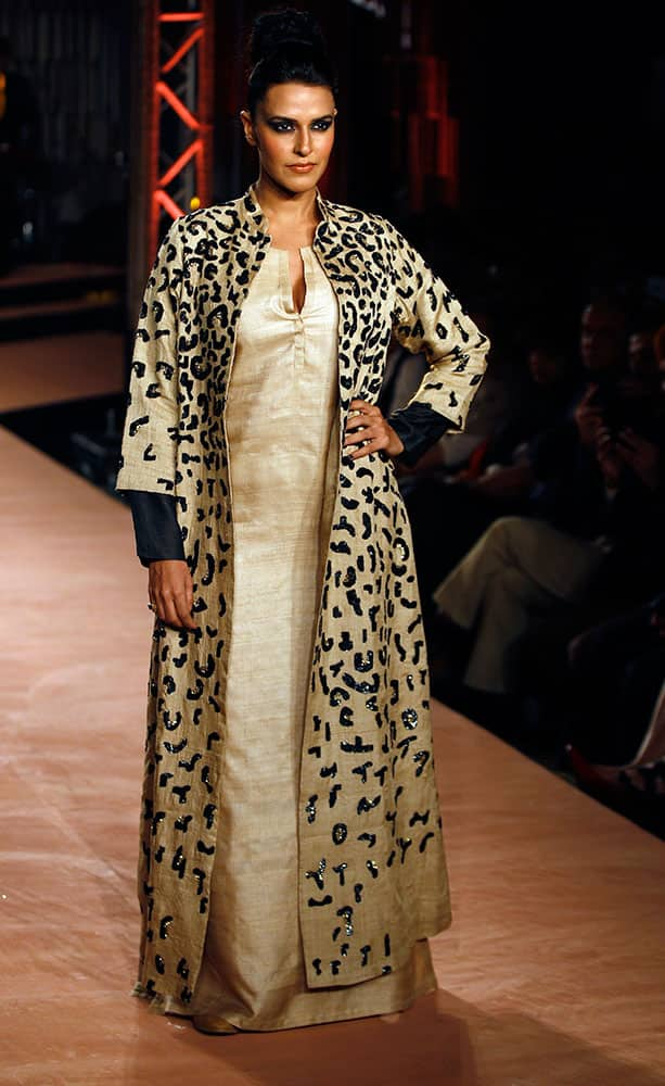 Bollywood actress Neha Dhupia displays a creation by Indian designers Abraham and Thakore during a fashion show in Bangalore.