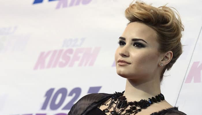 I was ashamed to show my arms: Demi Lovato